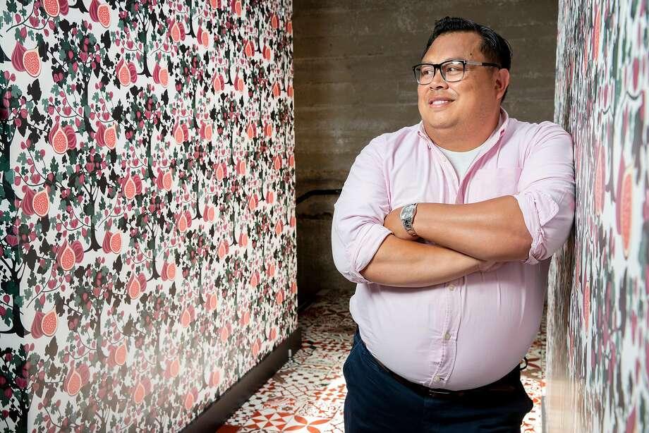Jon de la Cruz, the interior designer of Che Fico, at the Divisadero Street restaurant. Photo: Santiago Mejia / The Chronicle