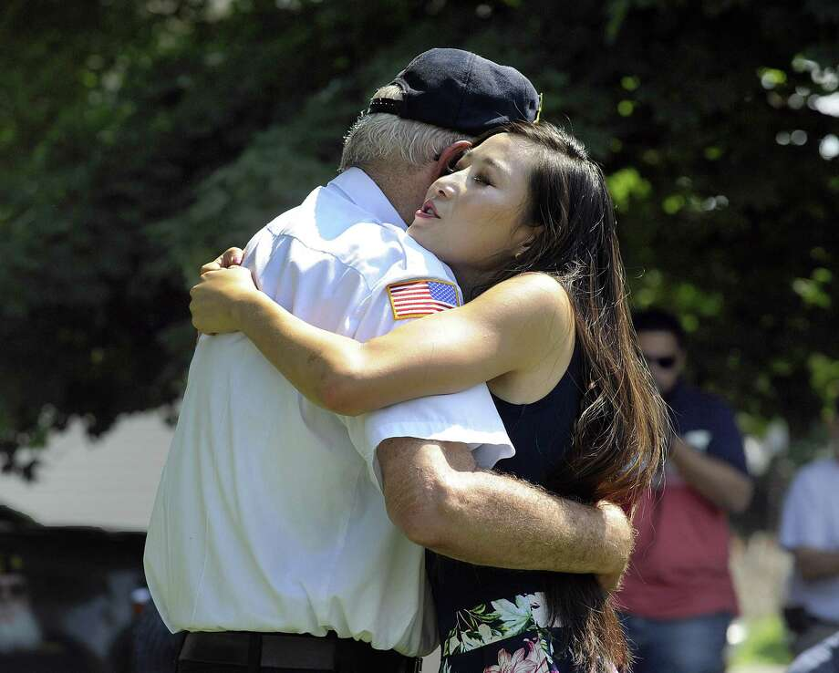 Korean War Veteran Kenneth Post, Jr. is hugged by Hannah Y Kim, after she gave him a pin -one that she ppresented to all the veterans gathered - to thank them for their service in the Korean War. Hannah Y Kim, stopped in Danbury Monday, July 16, 2018, as part of an ambitious three-month journey visiting Korean War memorials in all 50 states, to honor and remember those who served that conflict, 1950-53, and to help promote peace on the Korean Peninsula. Photo: Carol Kaliff / Hearst Connecticut Media / The News-Times