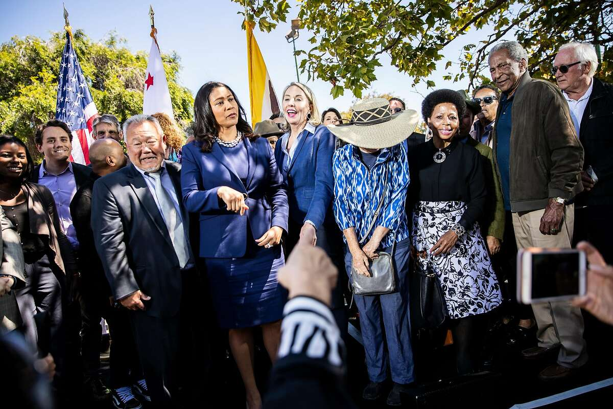 Mayor London Breed and newly appointed District 5 Supervisor Vallie Brown smile as they stand for a group photo following Brown's swearing-in ceremony at the Hayes Valley Playground in San Francisco, Calif. on Monday, July 16, 2018.