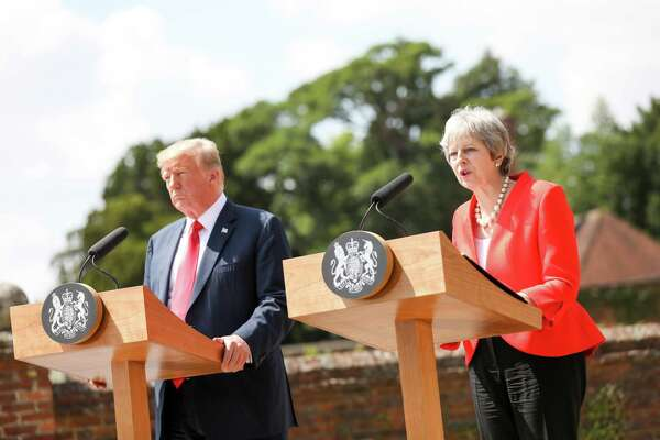 British Prime Minister Theresa May speaks during a news conference with U.S. President Donald Trump, left, in Aylesbury, U.K., on Friday, July 13, 2018.