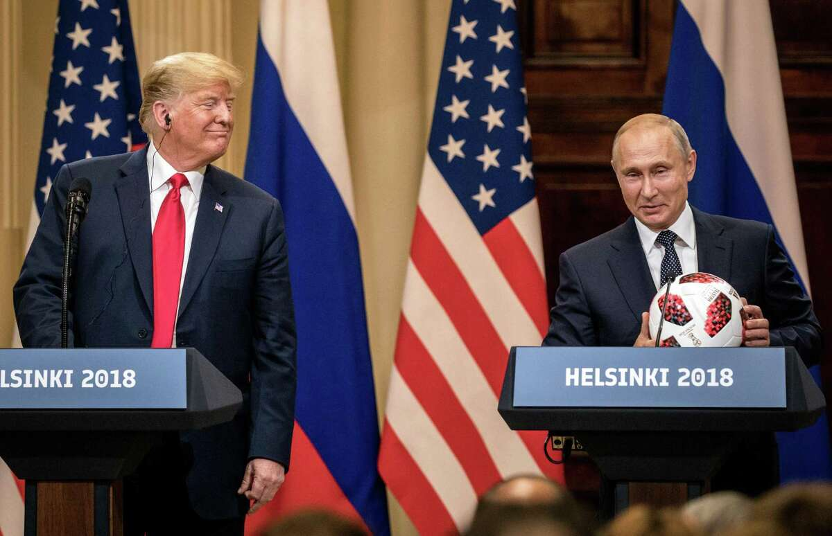 Russian President Vladimir Putin hands U.S. President Donald Trump a World Cup football during a joint press conference after their summit on July 16, 2018 in Helsinki, Finland. The two leaders met one-on-one and discussed a range of issues.