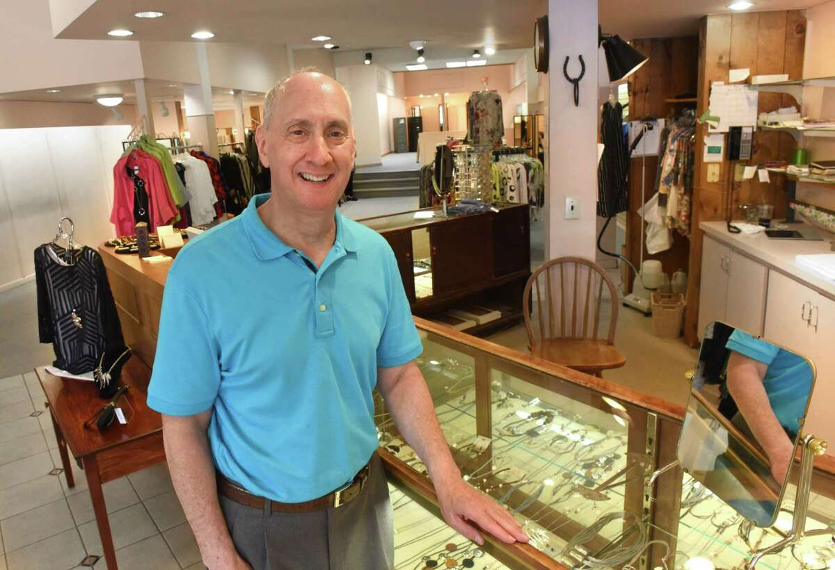 Owner Peter Weissman stands at the counter in Casual Set at Stuyvesant Plaza on Monday, July 16, 2018 in Guilderland, N.Y. After 49 years, the store is moving to Newton Plaza in Loudonville. (Lori Van Buren/Times Union)