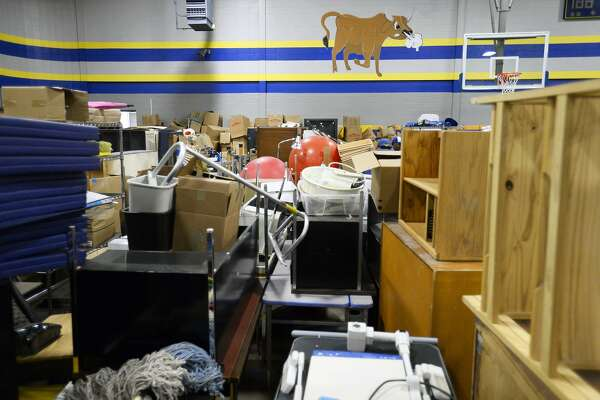 Furniture and other classroom items fill the gym at Hamshire-Fannett Middle School as they near completion of repairs from Tropical Storm Harvey. The district's middle and intermediate schools will be ready for students by the first day of school, Monday, Aug. 27, said superintendent Dwaine Augustine. More than 50 volunteers with the United Way and the district's high school students helped move the items out of the gym. Photo taken Monday 7/16/18 Ryan Pelham/The Enterprise