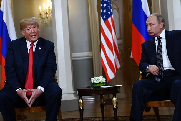 US President Donald Trump (L) and Russian President Vladimir Putin are pictured ahead a meeting in Helsinki, on July 16, 2018. / AFP PHOTO / Brendan SmialowskiBRENDAN SMIALOWSKI/AFP/Getty Images