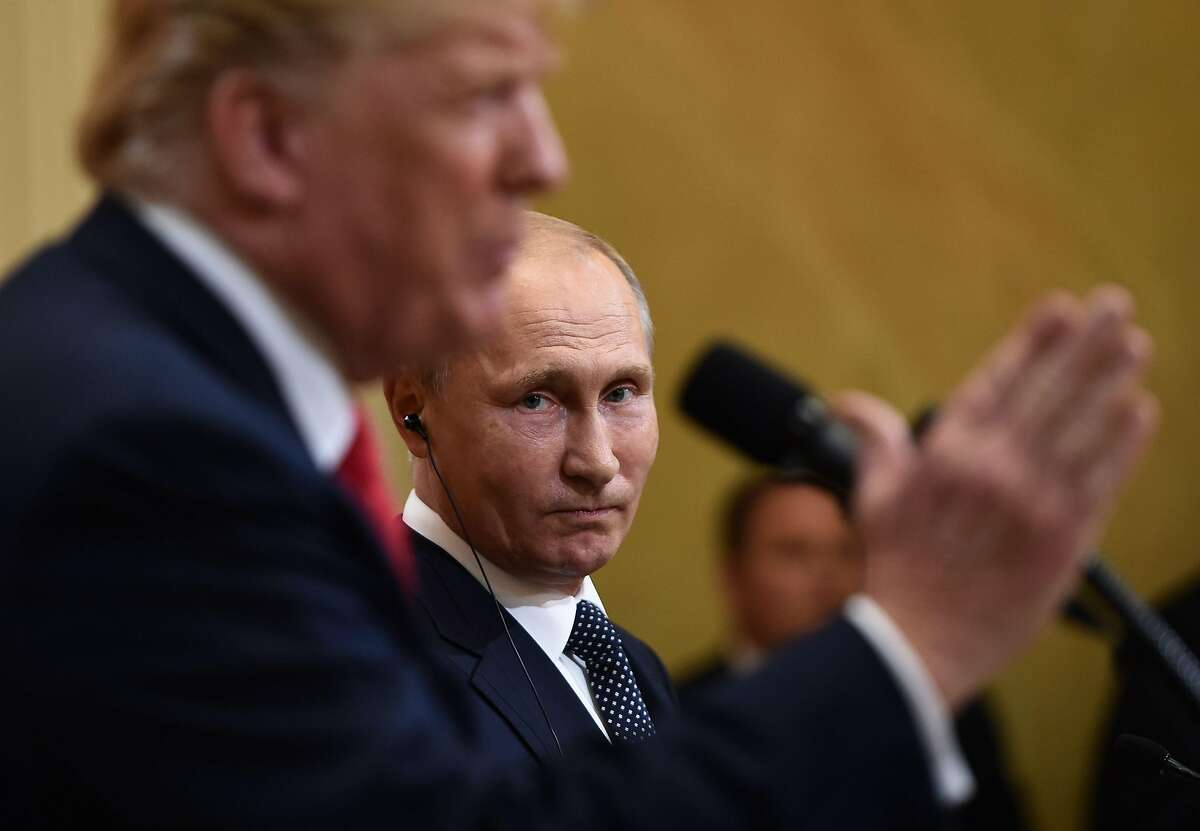 US President Donald Trump and Russia's President Vladimir Putin attend a joint press conference after a meeting at the Presidential Palace in Helsinki, on July 16, 2018. / AFP PHOTO / Brendan SMIALOWSKIBRENDAN SMIALOWSKI/AFP/Getty Images