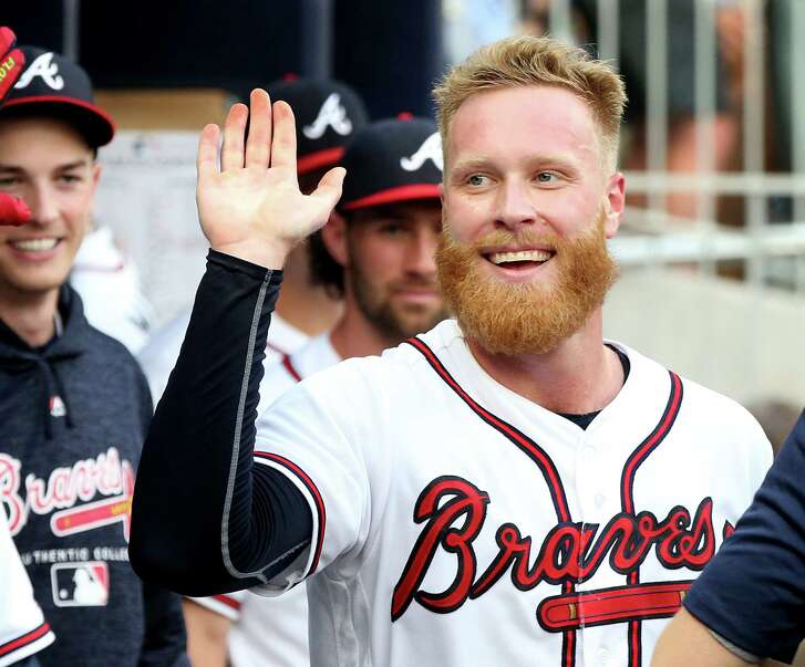 Atlanta Braves pitcher Mike Foltynewicz gets high fives in the dugout scoring on a Ozzie Albies sacrafice fly against the Toronto Blue Jays during the second inning on Wednesday, July 11, 2018, at SunTrust in Atlanta.