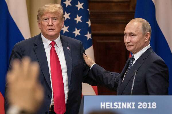 HELSINKI, FINLAND - JULY 16:  U.S. President Donald Trump (L) and Russian President Vladimir Putin shake hands during a joint press conference after their summit on July 16, 2018 in Helsinki, Finland. The two leaders met one-on-one and discussed a range of issues including the 2016 U.S Election collusion.  (Photo by Chris McGrath/Getty Images)