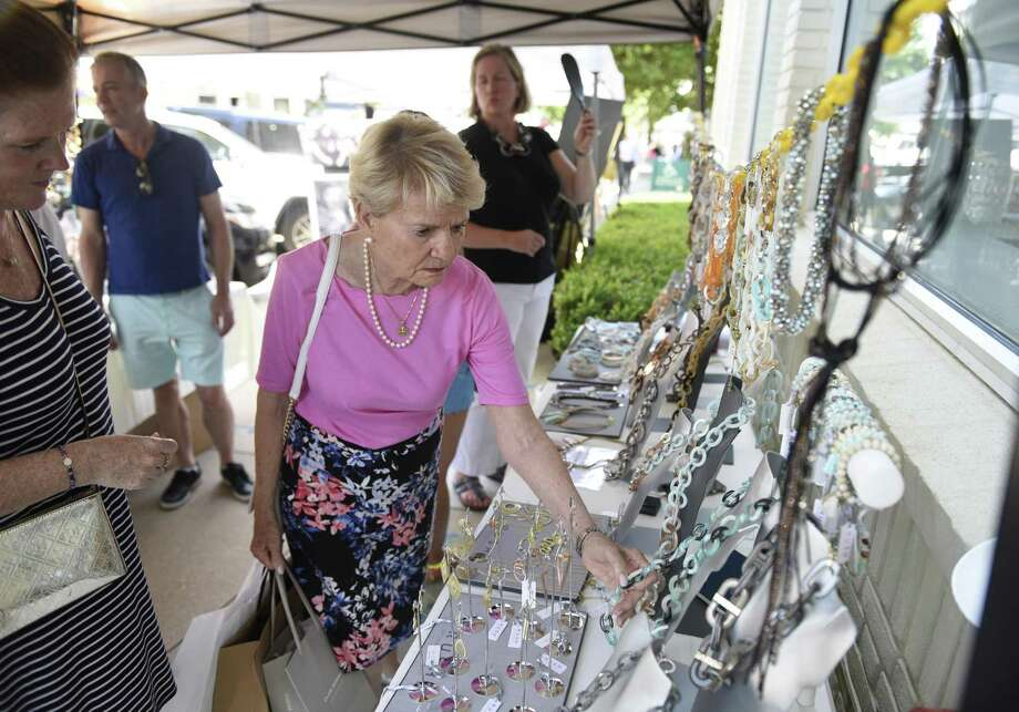 Folks browse sale items at the 2018 Sidewalk Sale Days in downtown Greenwich on Thursday. Photo: Tyler Sizemore / Hearst Connecticut Media / Greenwich Time