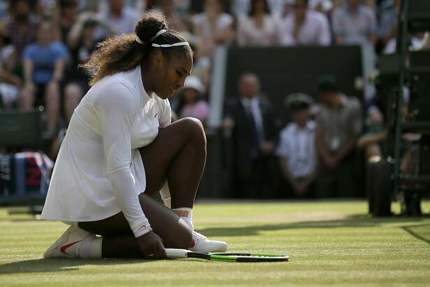 Serena Williams of the United States kneels after losing a point to Germany's Angelique Kerber during their women's singles final match at the Wimbledon Tennis Championships, in London, Saturday July 14, 2018.(AP Photo/Tim Ireland)