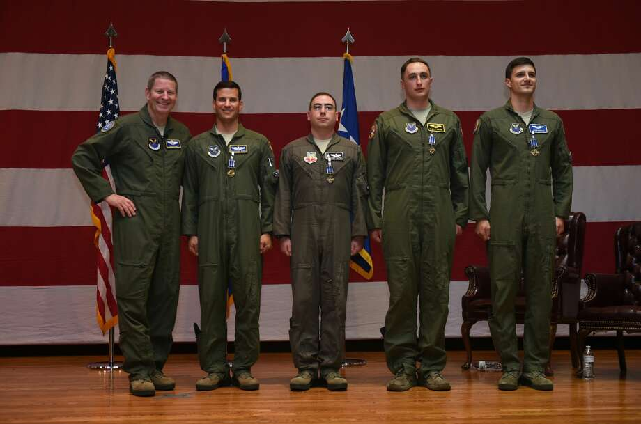 U.S. Air Force Gen. Robin Rand, commander of Air Force Global Strike Command, left, takes a group photo with the B-1B Lancer aircrew during a Distinguished Flying Cross medals presentation, at Dyess Air Force Base, Texas, July 13, 2018. Rand formally recognized the heroism and exceptional professionalism of the B-1B aircrew members involved in the May 1, 2018, in-flight emergency and resulting emergency landing in Midland, Texas. Aircrew members on that flight were Maj. Christopher N. Duhon, Air Forces Strategic - Operations Division chief of Future Operations, Barksdale AFB, La., and an instructor pilot with duties at the 28th Bomb Squadron; Capt. Matthew Leroy Sutton, 28th BS weapons system officer instructor; 1st Lt. Joseph Welch, 28th BS student pilot; and 1st Lt. Thomas C. Ahearn, then 28th BS student weapons system officer who has since completed training and is currently assigned to Ellsworth Air Force Base. Photo:  (U.S. Air Force Photo By Senior Airman Emily Copeland)