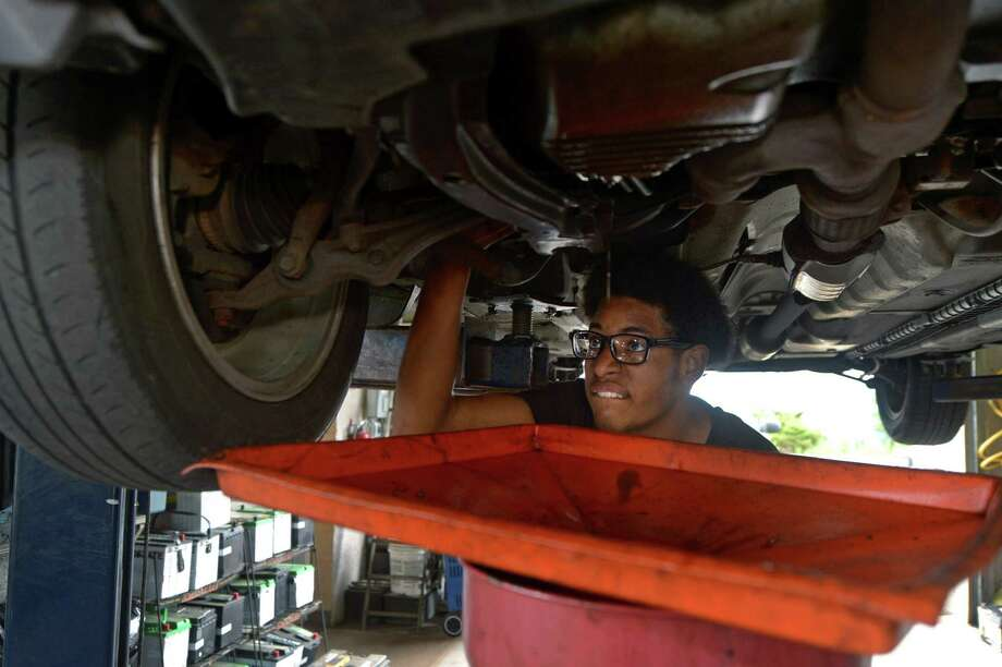 As a participant in the Mayor's Summer Youth Employment Program, Clive Bey is learns auto mechanics Wednesday, July 11, 2018, at Longo's Auto Repairs on South Water Street in Norwalk, Conn. Photo: Erik Trautmann / Hearst Connecticut Media / Norwalk Hour