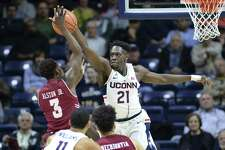 UConn's Mamadou Diarra (21) is out four to six months after undergoing knee surgery on Monday.