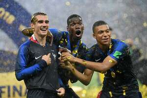 MOSCOW, RUSSIA - JULY 15:  Antoine Griezmann, Paul Pogba, and Kylian Mbappe of France celebrate following their sides victory in the 2018 FIFA World Cup Final between France and Croatia at Luzhniki Stadium on July 15, 2018 in Moscow, Russia.  (Photo by Matthias Hangst/Getty Images)