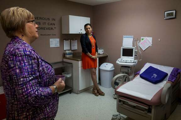 Andrea Ferrigno, corporate vice president of Whole Woman's Health, right, and Amy Hagstrom Miller, president, speak inside the Austin, Texas location of Whole Woman's Health during the reopening of the flagship abortion clinic on May 11, 2017. Whole Woman's Health is a plaintiff in a lawsuit challenging the legality of Texas' fetal burial law.