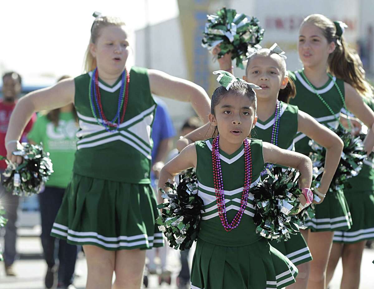 Garden Oaks Montessori cheerleaders march during the Crawfish Festival in the Heights parade Saturday, March 5, 2016, in Houston. ( James Nielsen / Houston Chronicle )