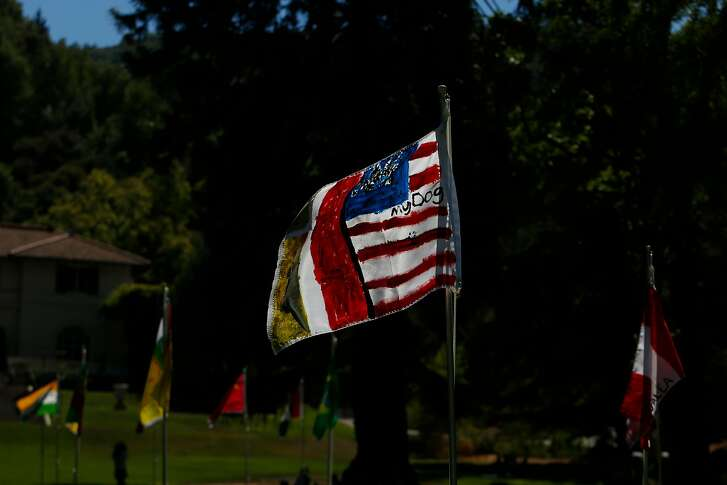 Immigrants made their own flags for the installation of Saudade (Our Flags) by Brazilian artist Maril� Dardot at Montalvo on Sunday, July 15, 2018 in Saratoga, Calif. Many of them had personal references to their home countries.