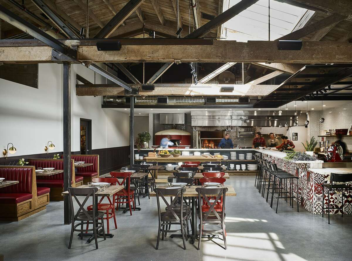 Che Fico restaurant in San Francisco features Italian cuisine with handmade pastas rolled out in front of diners. The restaurant features several areas with booths and different styles of tables so that diners can come multiple times a day and feel like they're having a different experience, said interior designer Jon de la Cruz.