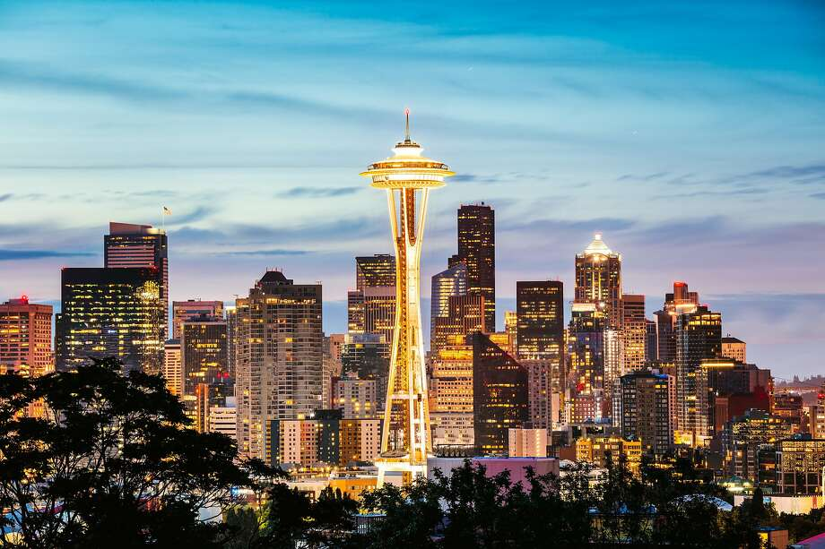 Seattle earns the second-most of any metro area in the West, according to the Bureau of Labor Statistics, but spends the most.  Keep clicking to see how Seattleites spend their cash... Photo: Matteo Colombo / Getty Images