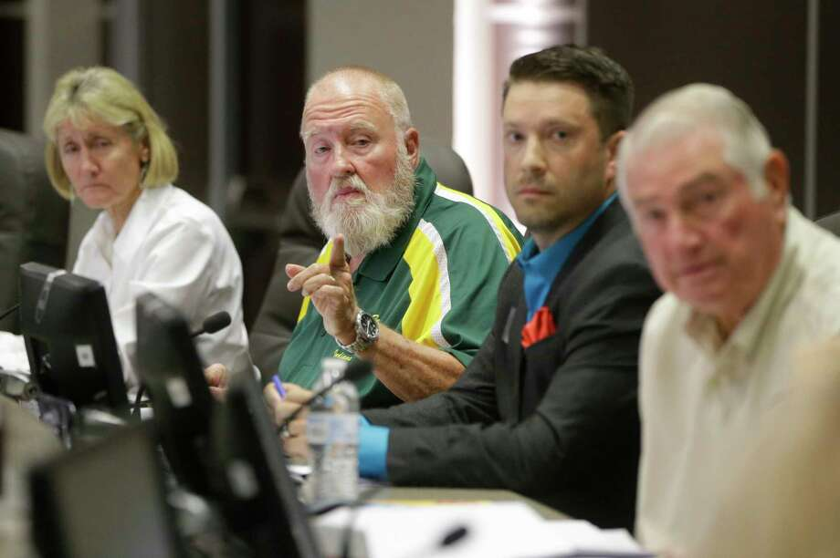 "Superintendent Leigh Wall, left, J. R. ""Rusty"" Norman, president, Eric E. Davenport, and John Rothermel, vice president, right, area shown during the Santa Fe ISD trustees meeting Monday, July 16, 2018, in Santa Fe. They voted to install metal detectors in each of the district's schools.