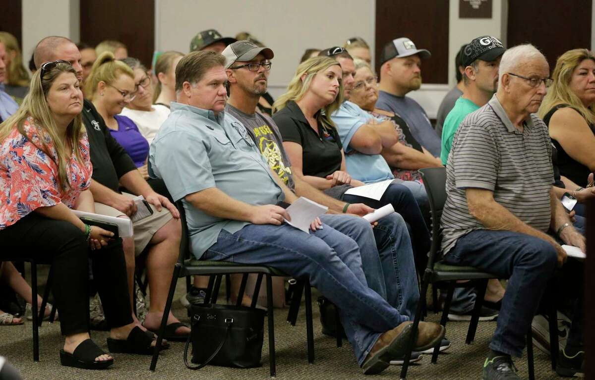 People attend the Santa Fe ISD trustees meeting Monday, July 16, 2018, in Santa Fe. They voted to install metal detectors in each of the district's schools.