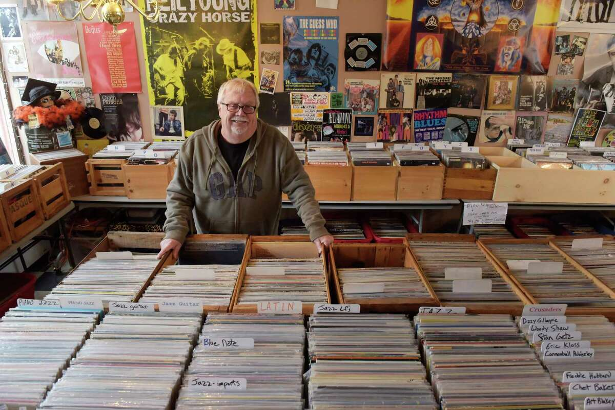 Jim Barrett at River Street Beat Shop in Troy, N.Y. Barrett co-owns the store with his son Liam Barrett and says the Troy farmers market has been bad for business. (Paul Buckowski / Times Union)