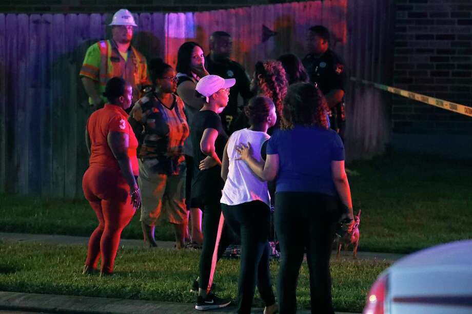A woman is comforted as they watch authorities investigate the scene of a homicide and gas leak in the 20000 block of Rene Creek Court, Monday, July 16, 2018, in Spring. Photo: Karen Warren, Houston Chronicle / © 2018 Houston Chronicle