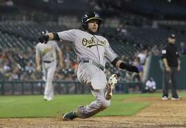 Oakland Athletics' Jed Lowrie scores from second on a single by Dustin Fowler during the ninth inning of a baseball game against the Detroit Tigers, Tuesday, June 26, 2018, in Detroit. (AP Photo/Carlos Osorio)
