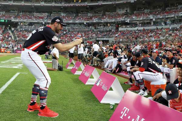 WASHINGTON, DC - JULY 16:  Justin Verlander #35 of the Houston Astros and the American League takes a photo during the T-Mobile Home Run Derby at Nationals Park on July 16, 2018 in Washington, DC.