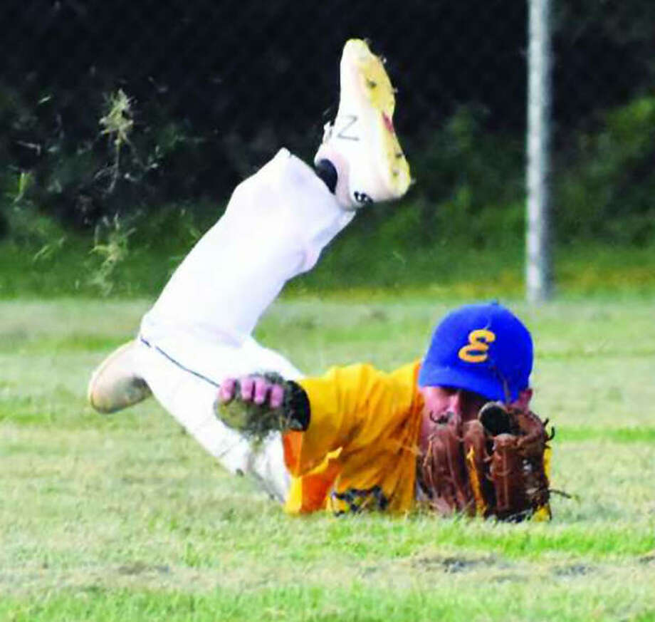 Edwardsville Post 199 center fielder Mikey Hampton makes a diving catch in the gap for the final out of the second inning against New Athens on Monday night at Hoppe Park in Edwardsville. Photo:       Matthew Kamp / Hearst Newspapers