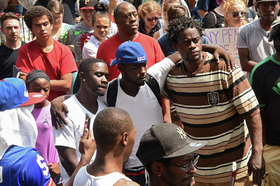 Angry and sad protestors are seen outside Troy City Hall during a protest of the shooting of Dahmeek McDonald on Wednesday, Aug. 16, 2017 in Troy, N.Y. A police officer shot the 22-year-old during a traffic stop. (Lori Van Buren / Times Union) Photo: Lori Van Buren / 20041306A