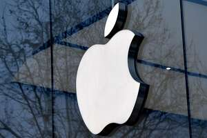 (FILES) In this file photo taken on February 8, 2018 the logo of the US multinational technology company Apple is on display on the facade of an Apple store in Brussels.  An ex-Apple engineer on July 10, 2018 was charged with stealing secrets from a hush-hush self-driving car technology project days before he quit to go to a Chinese startup. Xiaolang Zhang was in custody for stealing trade secrets from the Apple project, according to a copy of the criminal complaint posted online.  / AFP PHOTO / Emmanuel DUNANDEMMANUEL DUNAND/AFP/Getty Images
