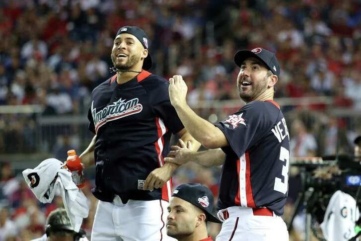 WASHINGTON, DC - JULY 16: George Springer #4 and Justin Verlander #35 of the Houston Astros and the American League react during the T-Mobile Home Run Derby at Nationals Park on July 16, 2018 in Washington, DC.