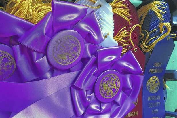 Ribbons wait to be placed during the Morgan County Fair last week. Fair season continues this week with events in Cass and Pike counties.