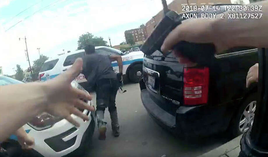 An image from police body cam video provided by the Chicago Police Department shows authorities trying to apprehend a man Saturday who appeared to be armed. Photo:       Chicago Police Department | AP