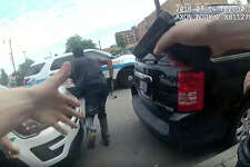 An image from police body cam video provided by the Chicago Police Department shows authorities trying to apprehend a man Saturday who appeared to be armed.