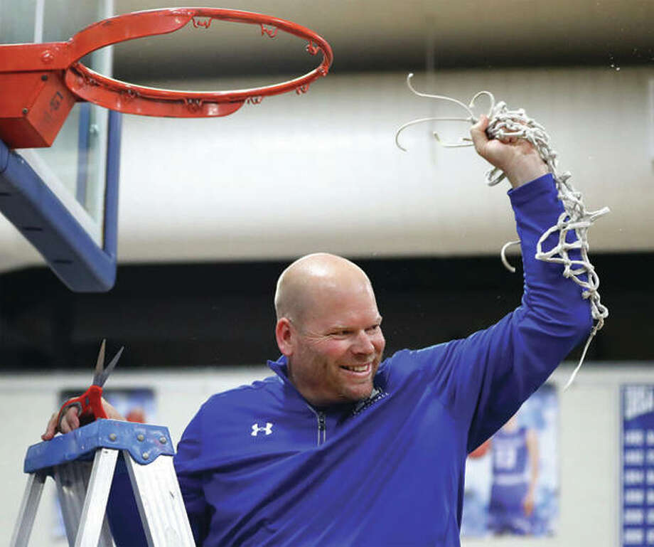 Marquette Catholic coach Lee Green reacts after cutting the net's final strand following the Explorers' Class 2A regional victory over Southwestern in Alton. Green is the 2018 Telegraph Small-Schools Girls Basketball Coach of the Year. Photo:       Billy Hurst / Telegraph File Photo