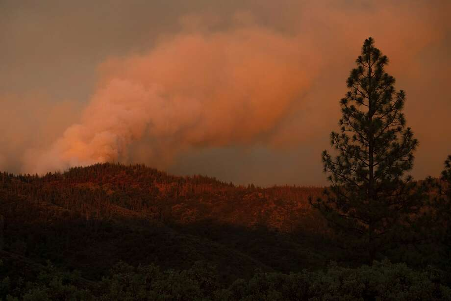 The Ferguson Fire burns along a ridgeline in unincorporated Mariposa County, Calif, on Monday, July 16, 2018. (AP Photo/Noah Berger) Photo: Noah Berger / Associated Press