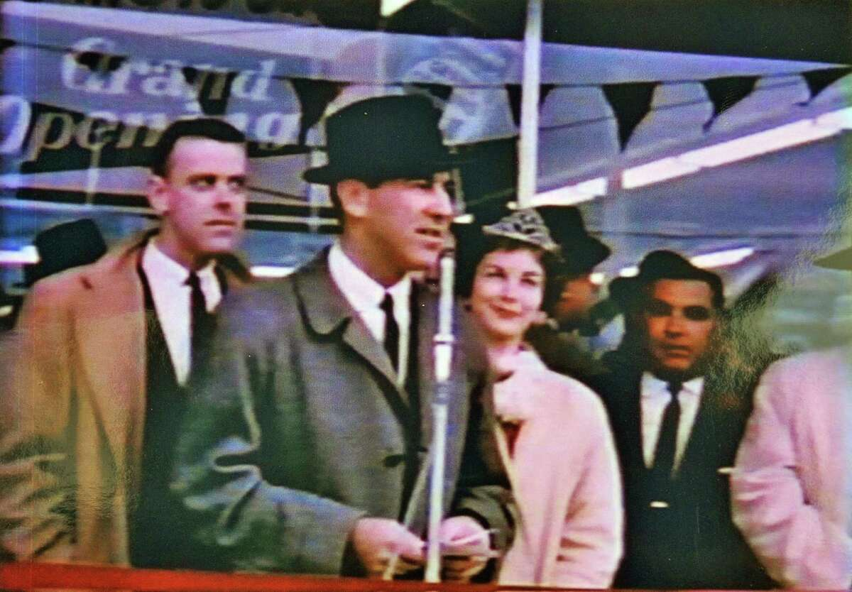 Photo of Lewis Swyer, (center) founder of Stuyvesant Plaza, at the plaza's grand opening November 4, 1959.