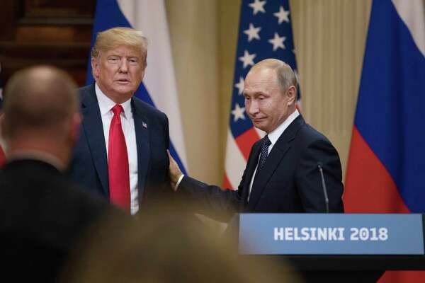 President Donald Trump, left, and Russian President Vladimir Putin prepare to leave following a news conference in Helsinki, Finland, on Monday, July 16, 2018.