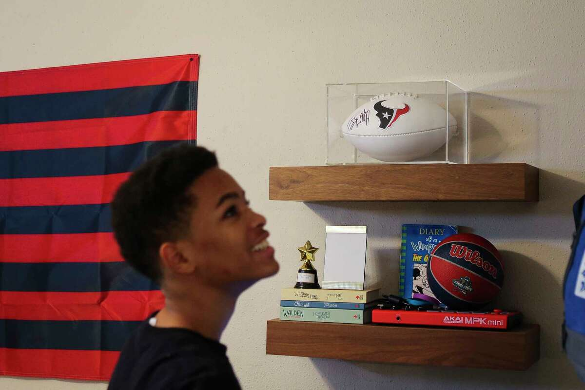 Arica Bibbs son explores his newly furnished and re-designed room.
