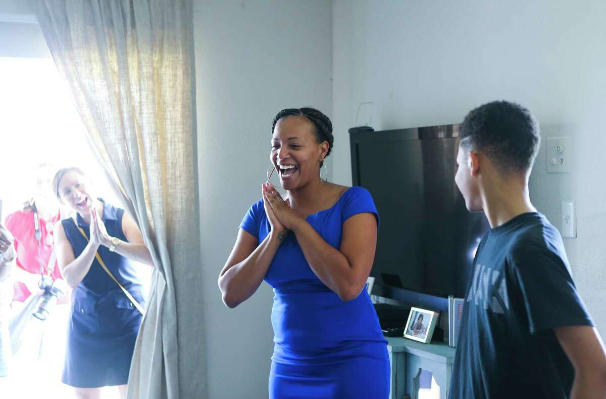 Arica Bibbs reacts as she sees her newly furnished and re-designed apartment care of the Houston chapter of Dwell With Dignity.