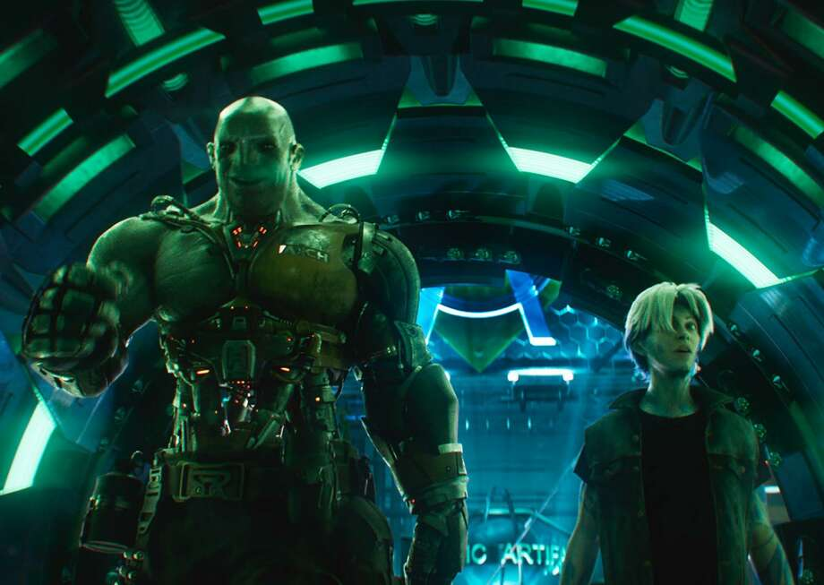 """Aech (left) and Parzival are in-game buddies i n""""Ready Player One,"""" a film by Steven Spielberg. Photo: Jaap Buitendijk /Warner Bros Pictures / © 2017 Warner Bros. Entertainment Inc.,"""