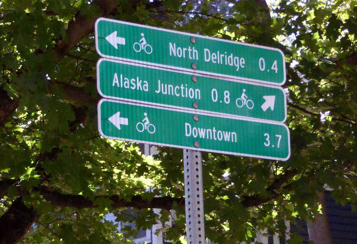 A bike trail sign in Seattle with sites on the route.