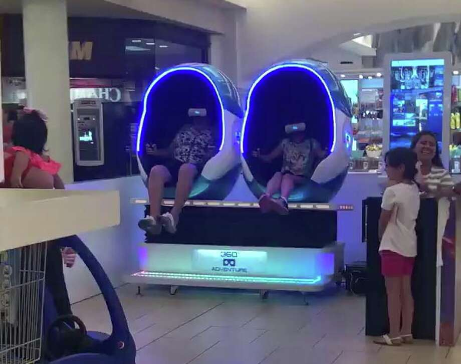 Video of a woman who participated in a virtual reality experience at Mall del Norte on Sunday has gone viral on Facebook. Photo: Jesse Muniz