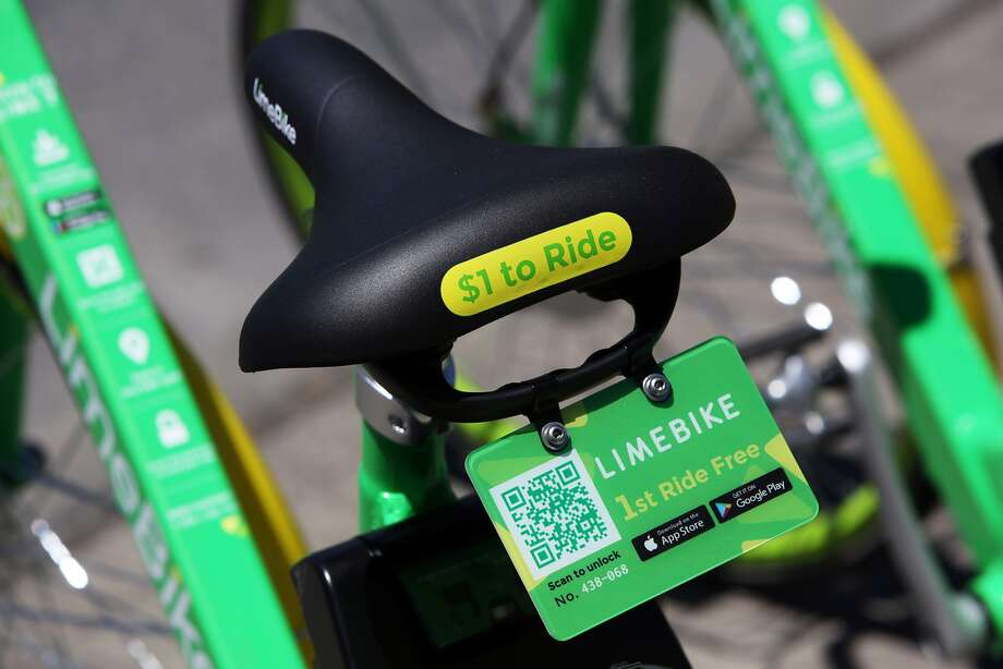 LimeBike, one of two dock-less bike share programs in Seattle, has placed bikes for public use around the city, including these two in the lower Queen Anne area of Seattle. Bikes are unlocked via an app and do not come with helmets. Photo: Genna Martin / SeattlePI.com