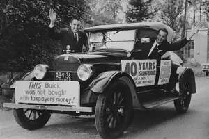 Rev. Robert Hudnut, at right, and running mateCharles Liddle, at left, campaign for mayor and common council president, respectively, in Albany.
