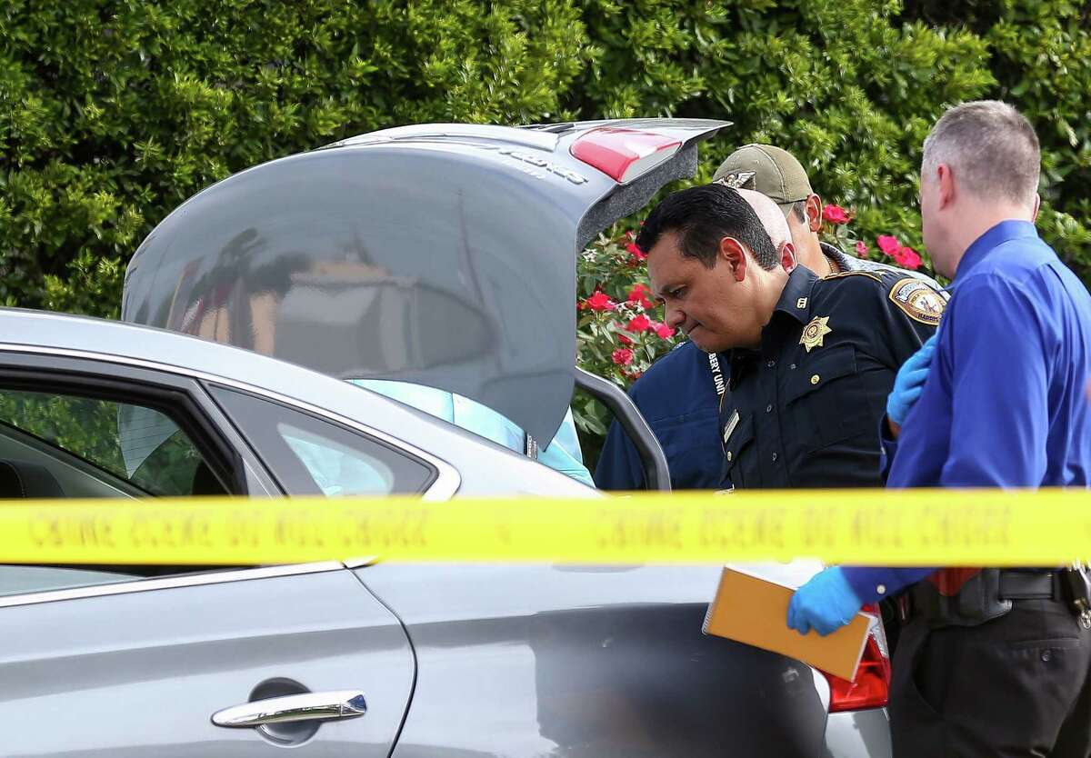 Harris County Sheriff Ed Gonzalez looks into the trunk of the vehicle Jose Rodriguez was driving before he was taken into custody on the 12100 block of Wortham Landing Drive Tuesday, July 17, 2018, in Houston. Rodriguez is a suspect in a recent murder spree.