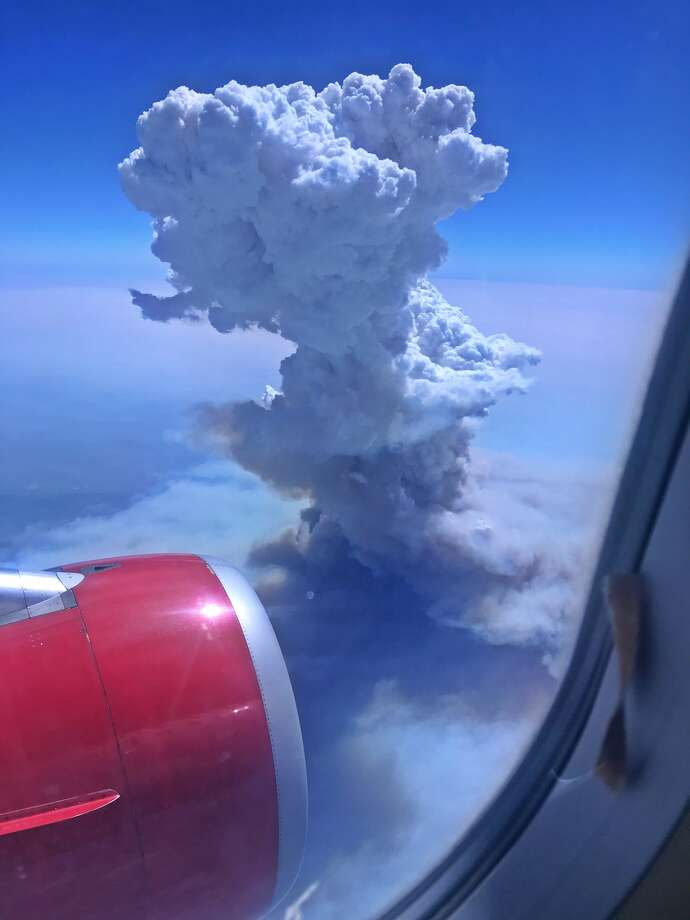 A massive pyrocumulus cloud billowed above the western edge of Yosemite National Park Sunday as the Ferguson Fire raced across a parched landscape. Photo: Ashley Watkins
