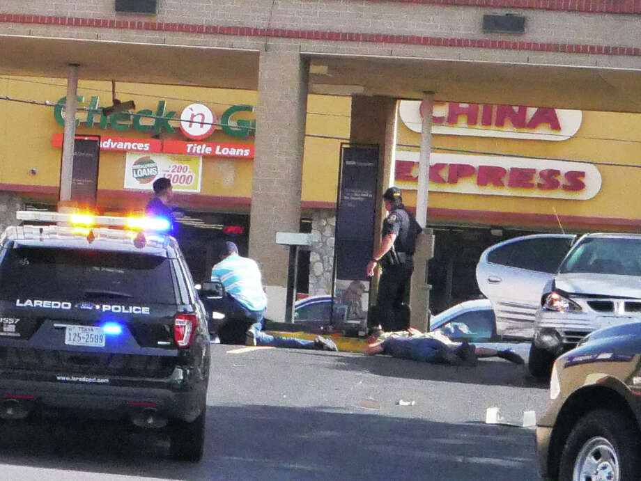 Police said a suspected wanted man was captured Tuesday morning following a brief vehicle pursuit. The chase ended with the suspect's vehicle and unmarked police unit crashing at Compass Bank on Jarvis Avenue and Guadalupe Street. Photo: Cuate Santos, Laredo Morning Times
