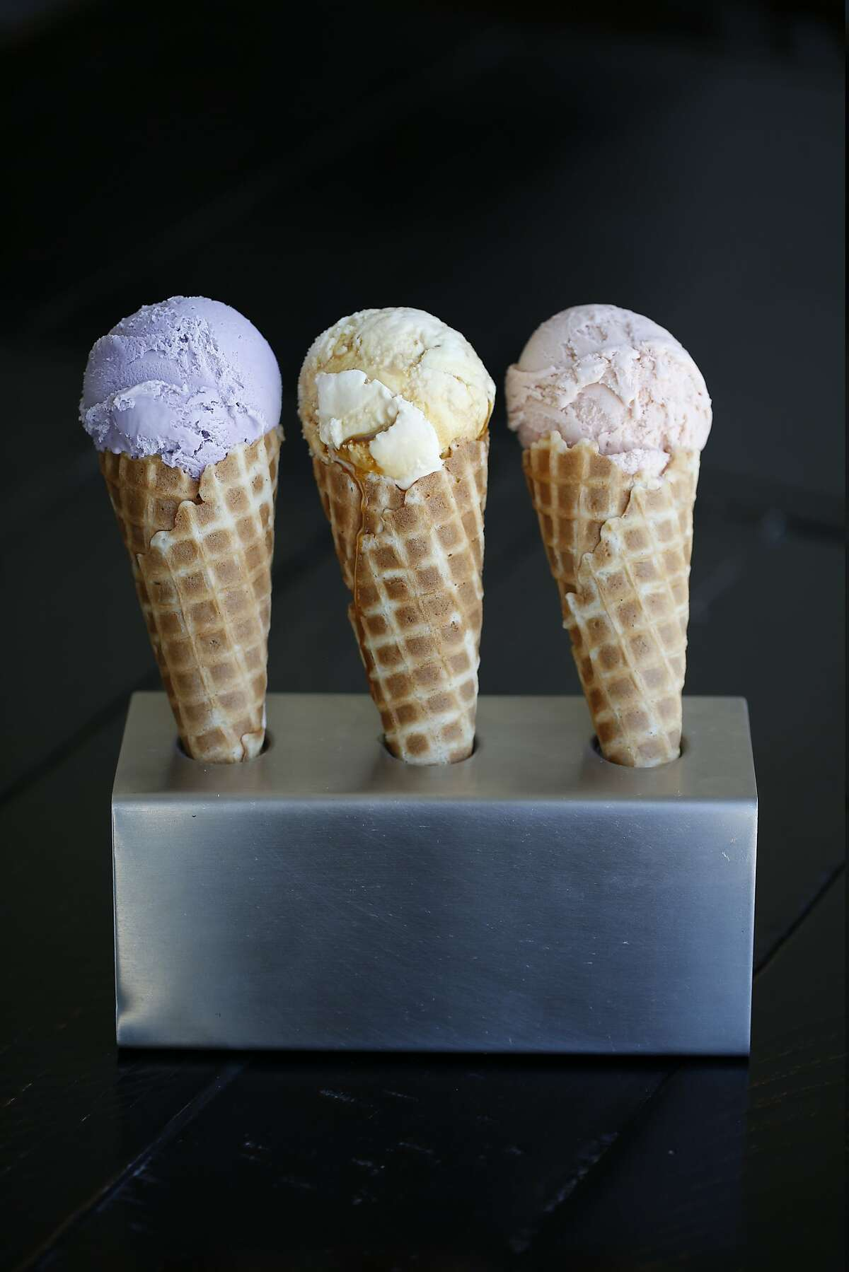 Left to right, Ube (made from purple yams), Flan, and Fruity Pebbles Ice Cream is featured at Mr. and Mrs. Miscellaneous on Monday, July 16, 2018 in San Francisco, Calif.